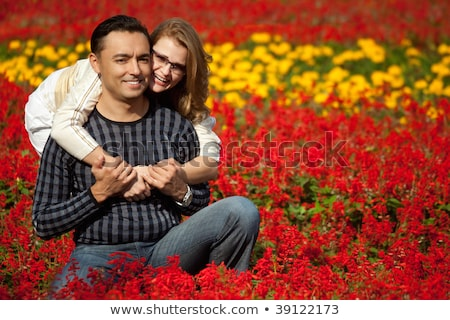 man and woman in brackets laughing in the flowers Stock photo © Paha_L