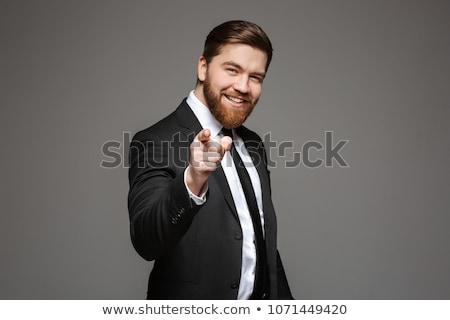 boldog · üzletember · mutat · ujj · kamera · portré - stock fotó © deandrobot