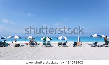 ビーチ シーン カラフル 傘 人 晴れた ストックフォト © avdveen
