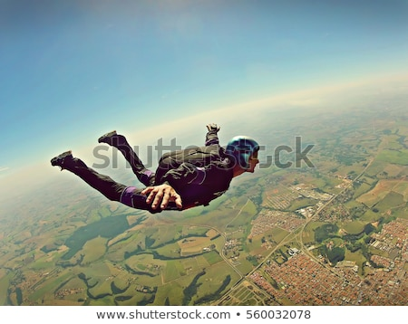 a boy skydiving stock photo © bluering