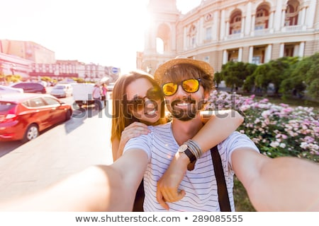 attractive young couple posing for a selfie stock photo © dash