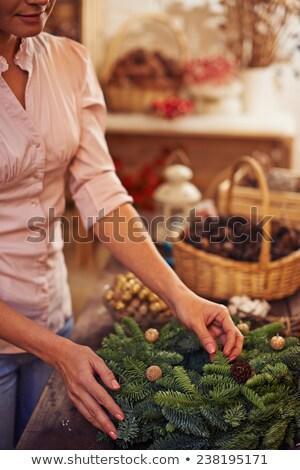 Woman decorating coniferous wreath Stock photo © dashapetrenko