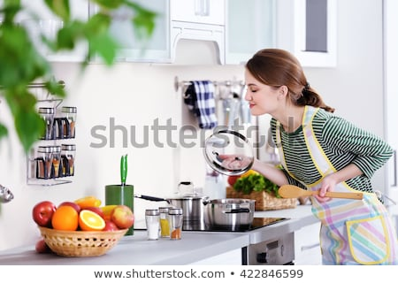 Background cooking or Woman cooking with ingredients spoon in her hands on background vegetable on b stock photo © Bigbubblebee99