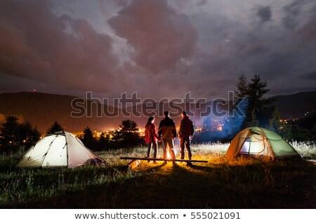 Casal de mãos dadas tenda menina esportes montanha Foto stock © deandrobot