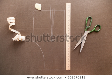 still life photo of a suit pattern template with tape measure c stock photo © yatsenko