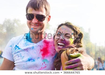 Portrait of happy couple in love on holi festival Сток-фото © Yatsenko