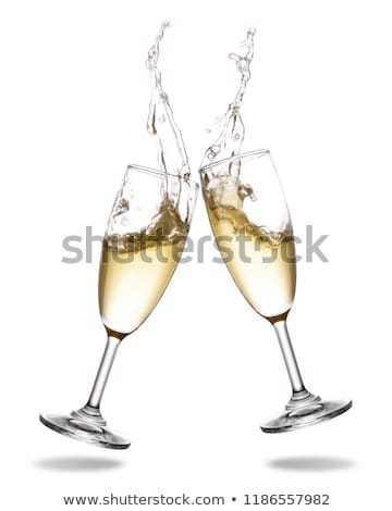Stock photo: Glass of yellow champagne with splashes bubbles