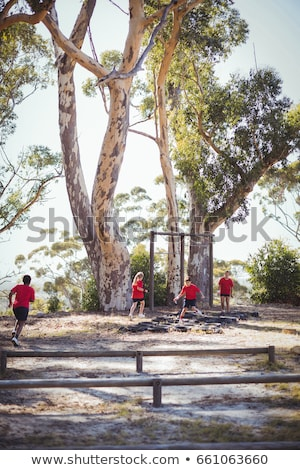 Kids jumping over the hurdles during obstacle course training Stock photo © wavebreak_media