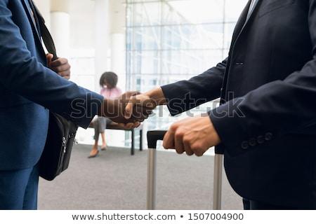 бизнесмен костюм Постоянный рук телефон Сток-фото © wavebreak_media