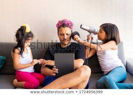 Daughter brushing fathers hair Stock photo © wavebreak_media