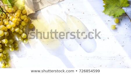 grapes on white table; seasoning vineyard background; Bottle and Stock photo © Konstanttin