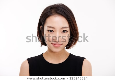 close up portrait of a smiling pretty asian woman stock photo © deandrobot