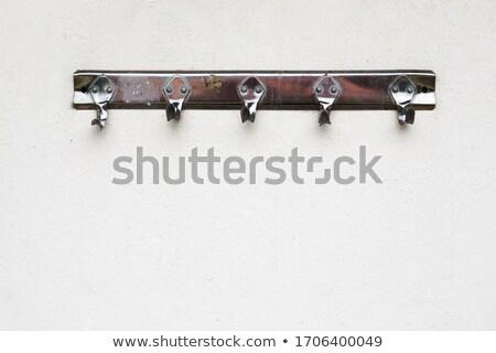 Kampó csatolva fal üres fém fehér Stock fotó © wavebreak_media