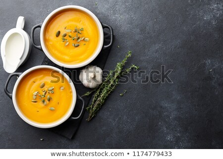 two bowls of homemade pumpkin soup stock photo © mpessaris