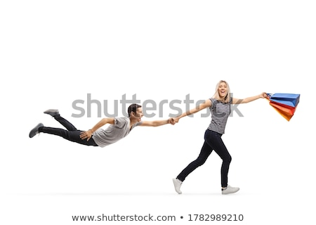 Young man and woman looking at shop wind Stock photo © IS2