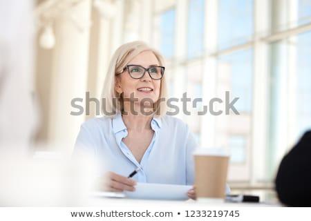 Idősebb üzletasszony megbeszélés üzlet iroda dolgozik Stock fotó © IS2