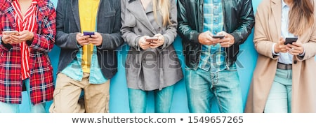 Teenage girl using cell phone Stock photo © IS2