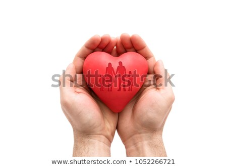 Red heart with imprinted family shape in man's hands.  Stock photo © sqback