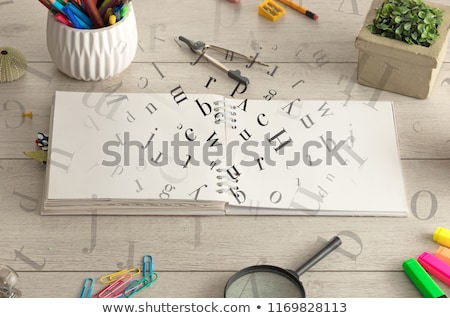 Open notebook on the floor with instruments nearby Stock photo © ra2studio