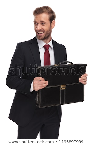 portrait of laughing businessman with suitcase looking down to s stock photo © feedough