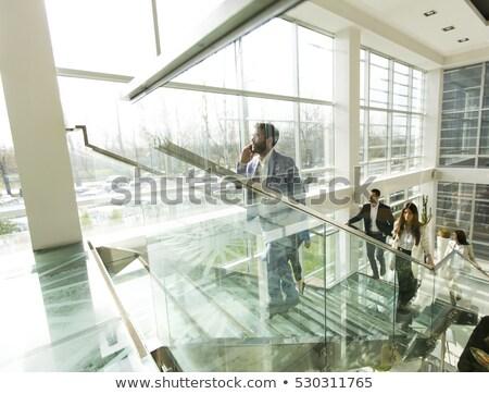Jovem empresária em cima negócio edifício celular Foto stock © boggy