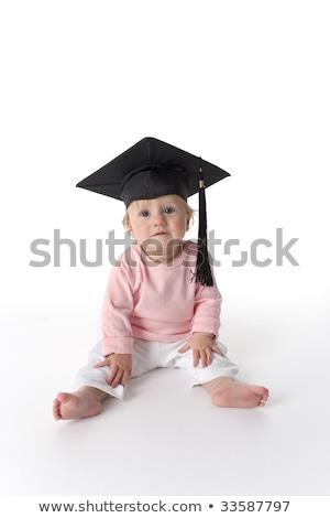 çocuk · mezuniyet · kız · elbise · şapka - stok fotoğraf © lopolo