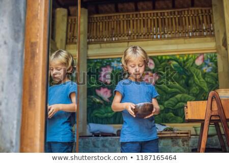 The boy is playing Kalimba. The musical instrument of Africa, Latin America and Bali Stock photo © galitskaya