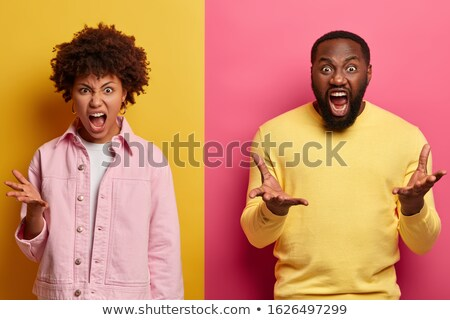 photo of irritated man in casual clothes screaming at woman stan stock photo © deandrobot