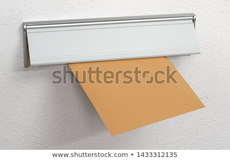 An unlabeled  brown envelope in a letterbox Stock photo © Zerbor