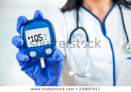 doctor with glucometer and patient at hospital Stock photo © dolgachov