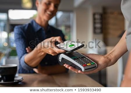 Kéz fizet mobiltelefon biztonságos fizetés üzlet Stock fotó © ra2studio