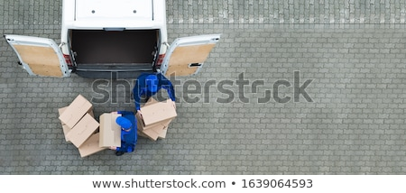 Male Movers Loading Cardboard Boxes In Truck On Street Stock photo © AndreyPopov