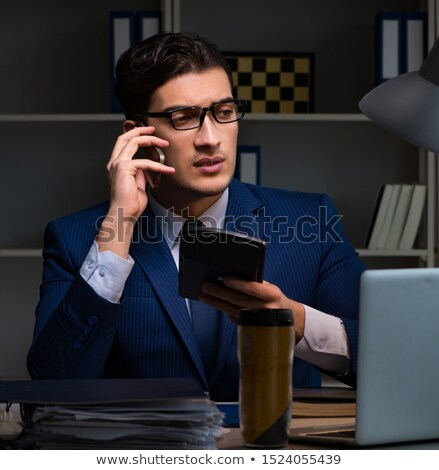 Auditor checking the accuracy of financial statements with calculator Stock photo © Elnur