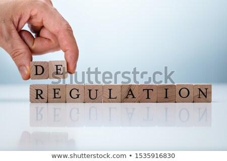 Hand Holding De Near Regulation Word Stock photo © AndreyPopov