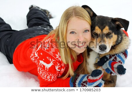 Pretty, young woman with her large black dog stock photo © lightpoet