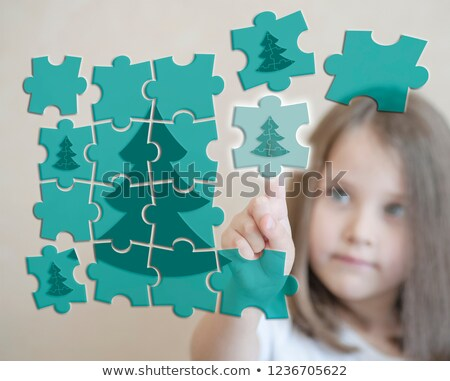 New Year's puzzle of a little baby girl on the background of luminous New Year's decoration Stock photo © ElenaBatkova