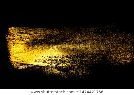 Golden paint brush stroke texture isolated on black background Stock photo © Anneleven