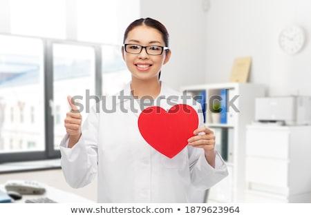 Feliz asiático mulher vermelho coração Foto stock © dolgachov