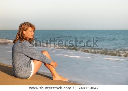 Kadın oturma plaj tek kadın boş rahatlatıcı Stok fotoğraf © pekour