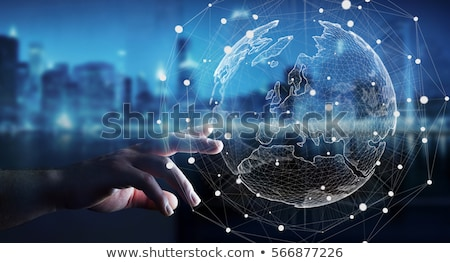 Stockfoto: A Business Man Is Using The Internet A Map Of The Earth With Gl