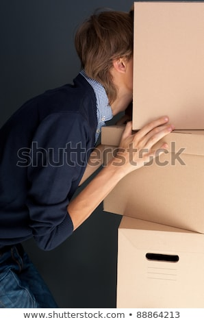 Stock foto: Portrait Of Anonymous Young Man With His Head Inside Box