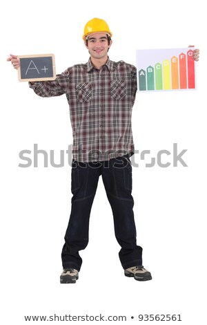 Man stood with chalk board and energy rating poster Stock photo © photography33