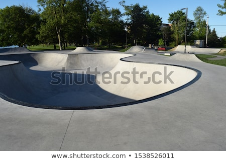 skater jumping at the concrete skate park stock photo © arenacreative