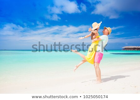 couple · vacances · plage · ciel · herbe - photo stock © photography33