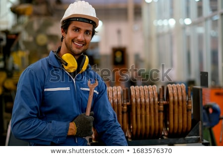 man holding a pipe wrench and copper pipes stock photo © photography33
