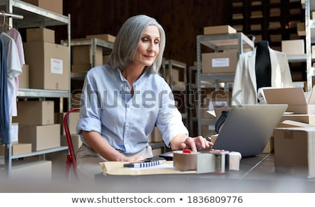 senior businesswoman sending e mails stock photo © photography33