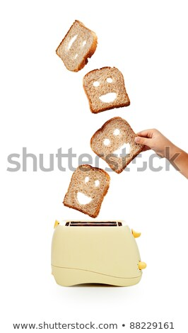 hand catches toast bread slices flying out of a toaster Stock photo © ozaiachin