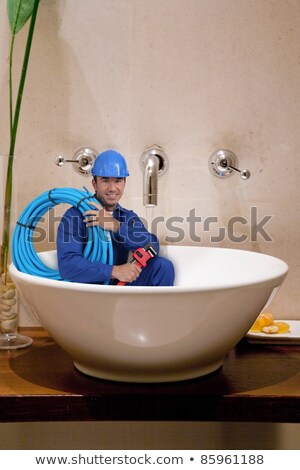 'reduced size' plumber in washbowl Stock photo © photography33