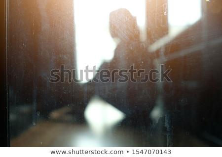 Higgadt nő sötét hely felhők arc Stock fotó © konradbak