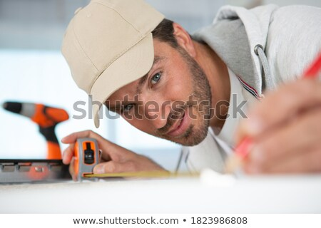 Tradesman marking a measurement with a pencil Stock photo © photography33